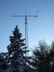 A heavy-duty ham radio tower supporting a large multi-band, multi-element HF yagi.