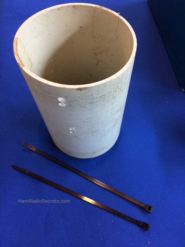 Holes in PVC pipe for coax RF choke tiewraps